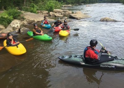 kayakers waiting in an eddy on the middle yough