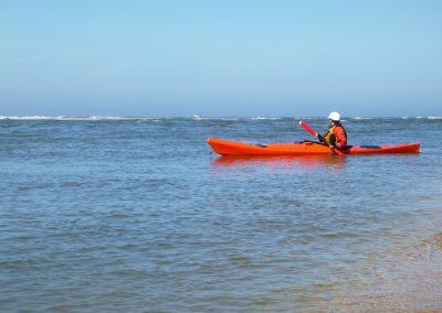 kayaker looking at the tide race waves matanzas inlet