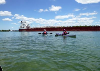 big freighter and kayaks