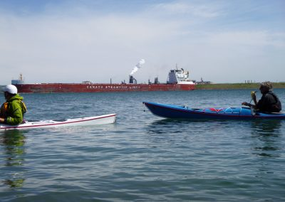 freighter and kayaks near soo locks