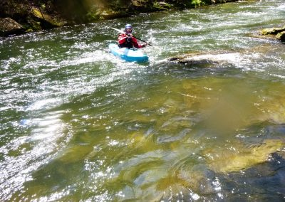 kayaker performing a high brace